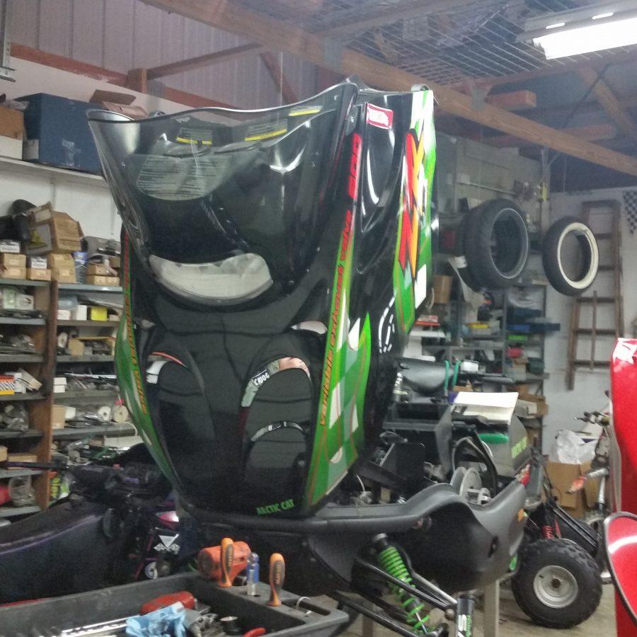snowmobile repair shop image